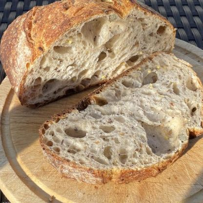 A loaf of Seeded Sourdough with a slice cut off