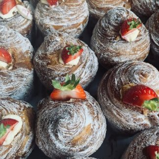 A selection of strawberry clotted cream cruffins