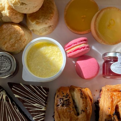 A close up of tarts, brownies and jam from the picnic box