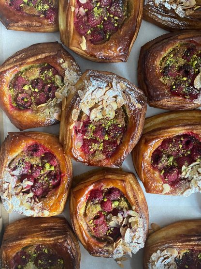 A selection of Raspberry & Pistachio Danishes