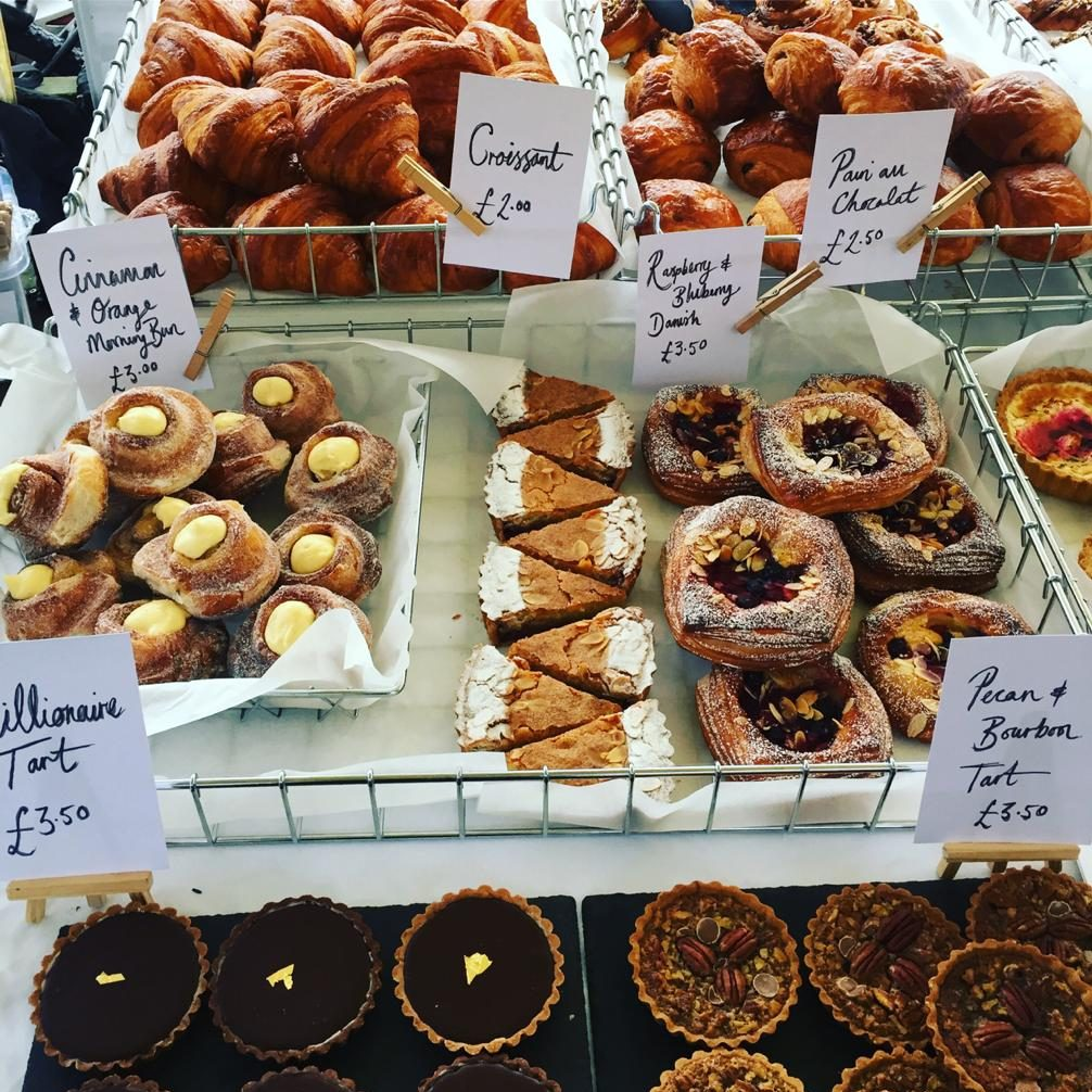 A market stall showing a selection of cakes