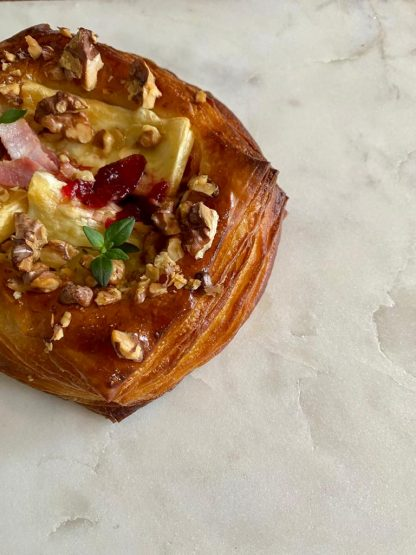 A single bacon, brie and cranberry danish