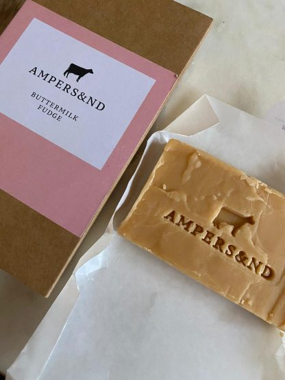 A picture of a piece of fudge alongside it's packaging