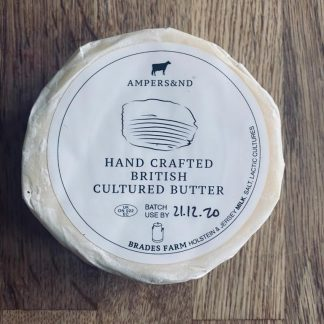 A picture of a single wheel of butter in its packaging