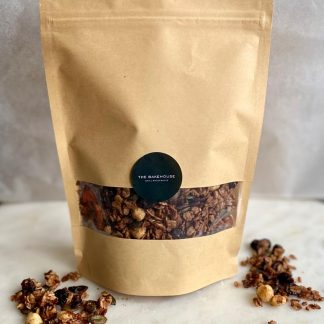 A packet of granola with some contents sprinkled either side