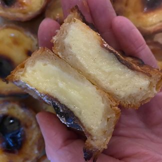 A Portuguese custard tart split down the middle
